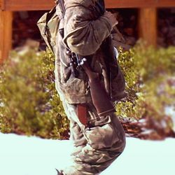 This undated file photo provided by the Iron County Sheriff's Office shows a man identified as Troy James Knapp, walking past a cabin in the remote southern Utah wildness near Zion National Park. Authorities say Knapp, captured by a motion-triggered surveillance camera sometime in December of 2011, has been linked to more than two dozen cabin burglaries over several years. He was arrested Tuesday near Ferron Reservoir.