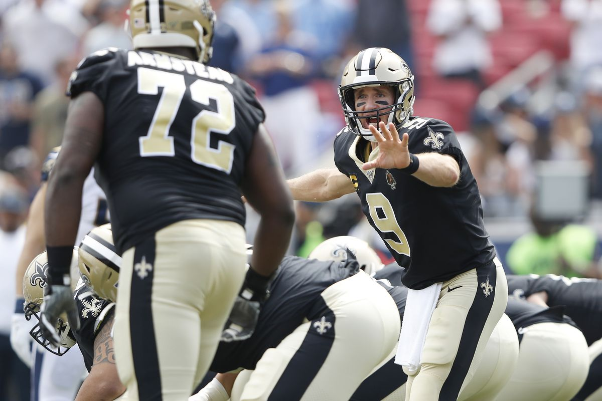Drew Brees of the New Orleans Saints communicates at the line of scrimmage during the first quarter against the Los Angeles Rams in the game at Los Angeles Memorial Coliseum on September 15, 2019 in Los Angeles, California.