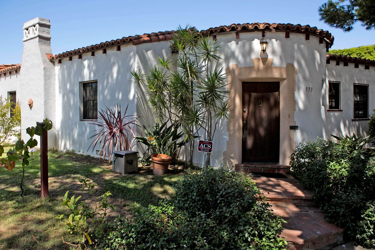 White Spanish-style home with a rounded entryway