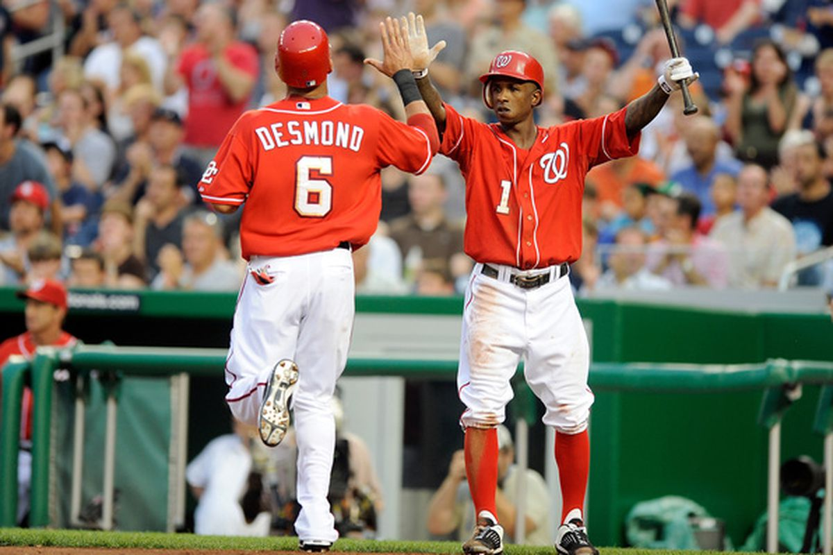 WASHINGTON - JUNE 04:  Ian Desmond #6 of the Washington Nationals celebrates with Nyjer Morgan #1 after scoring in the second inning against the Cincinnati Reds at Nationals Park on June 4, 2010 in Washington, DC.  (Photo by Greg Fiume/Getty Images)