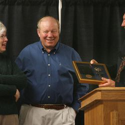 Gail and Larry Miller are presented as an honorary warden of the prison complete with a key from Department of Corrections Executive Director Scott Carver at the dedication of the new Larry and Gail Miller Public Safety Education and Training Center at the Sandy campus of Salt Lake Community College in Sandy, Utah, Nov. 30, 2006.  Photo by Tom Smart