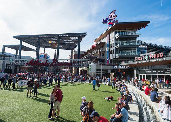 A fan plaza next to a large baseball stadium.