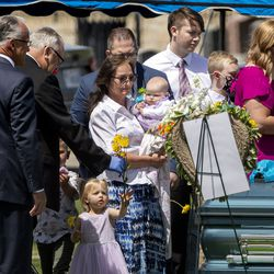 Marshall Crane, father of Katherine Butterfield, hands his granddaughter Brooklyn Butterfield flowers to place on her parents' caskets while his wife Rebecca Crane carries granddaughter Brighton. The family of Tony and Katherine Butterfield gathered in the Herriman City Cemetery for graveside services on Saturday, April 25, 2020. The couple was shot and killed at their home in West Jordan on Saturday, April 18, 2020. Albert Enoch Johnson was arrested the following Wednesday in Stockton, California, in connection with the Butterfields' deaths.