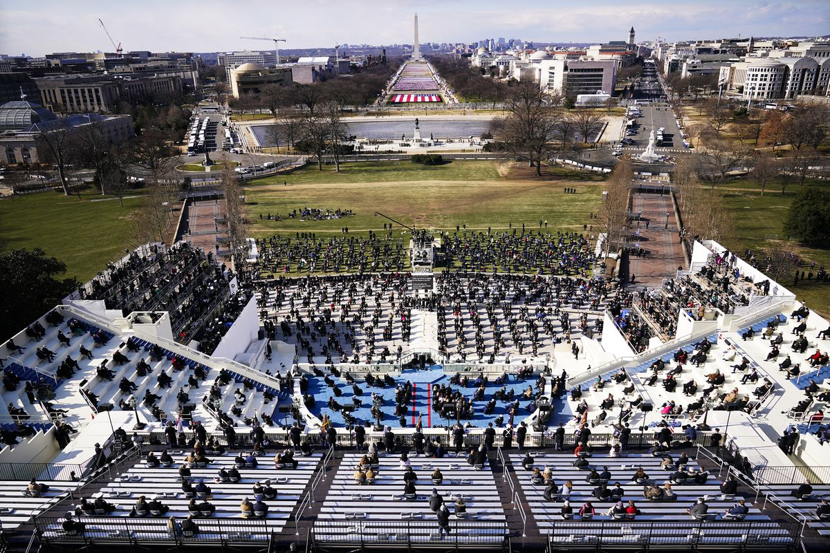 A wide view of a socially distanced crowd in stands at the Capitol inauguration.