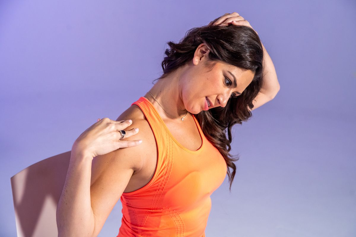 """An assisted neck stretch helps those who suffer from """"Text Neck."""""""