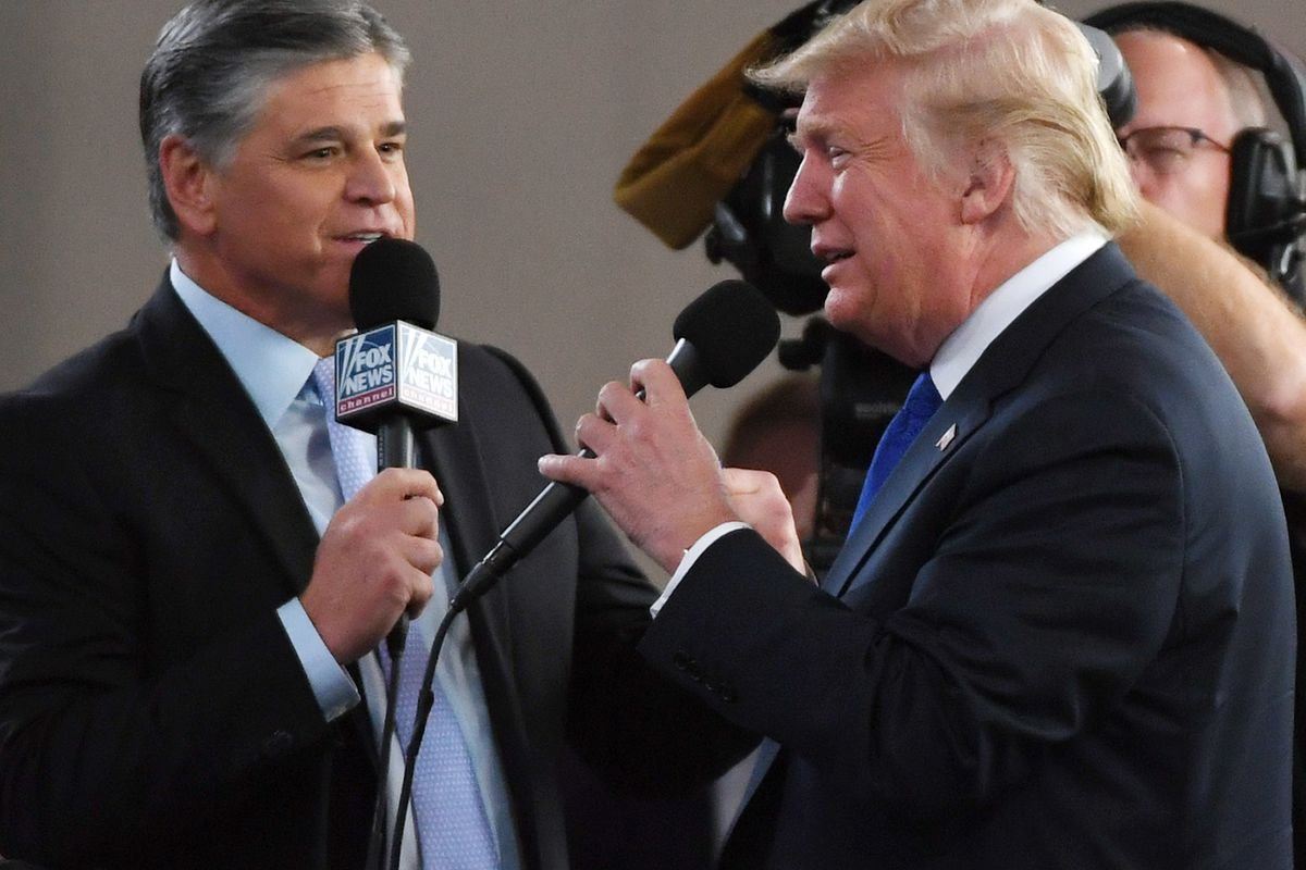 eacea8d0e Fox News Channel and radio talk show host Sean Hannity (L) interviews U.S  President Donald Trump before a campaign rally at the Las Vegas Convention  Center ...