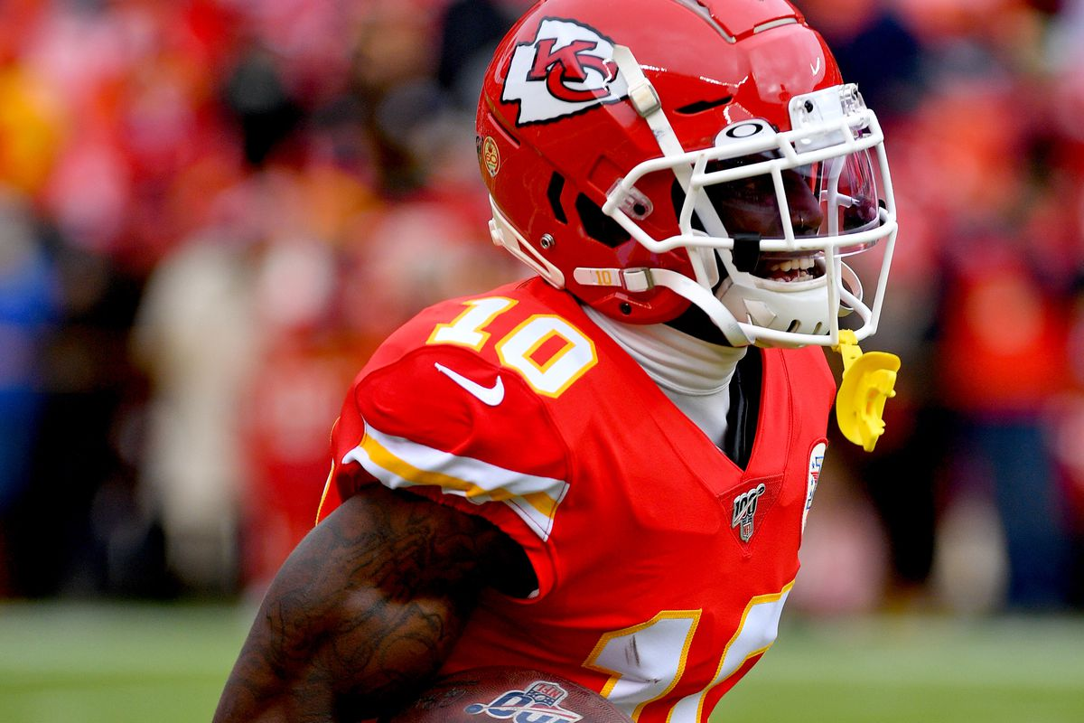 Kansas City Chiefs wide receiver Tyreek Hill warms up before the game against the Los Angeles Chargers at Arrowhead Stadium.