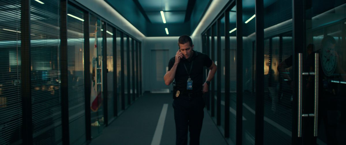 Jake Gyllenhaal on the phone in a glass-walled 911 call center in The Guilty