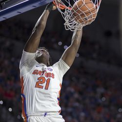 Florida forward Dontay Bassett (21) dunks the ball during the first half of an NCAA college basketball game against Auburn in Gainesville, Fla., Saturday, Feb. 24, 2018. Florida won 72-66.