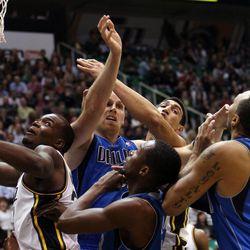 Utah Jazz and Dallas Mavericks players position for a rebound during NBA basketball in Salt Lake City, Monday, Jan. 7, 2013.