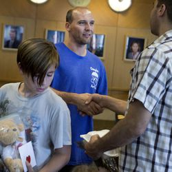 David McAlhany is thanked by Matthew Munoz and his son Jaycen after McAlhany brought 100 teddy bear to the patients of Shriners Hospitals for Children in Salt Lake City on Thursday, Sept. 14, 2017.