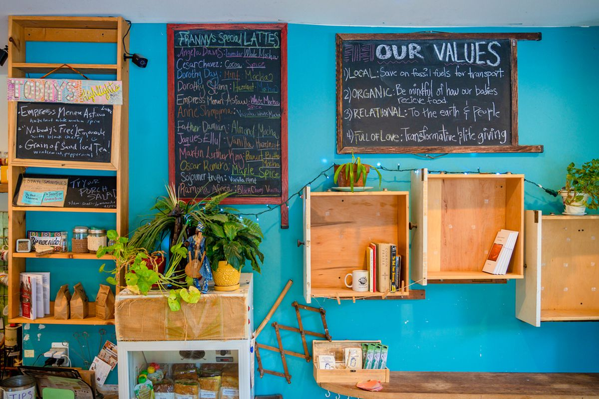 brightly colored cafe with turquoise wall and chalkboards