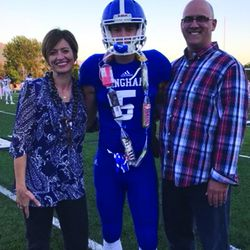 Dax Milne poses for a picture at Bingham's Senior Day with his parents, Jill and Darren.