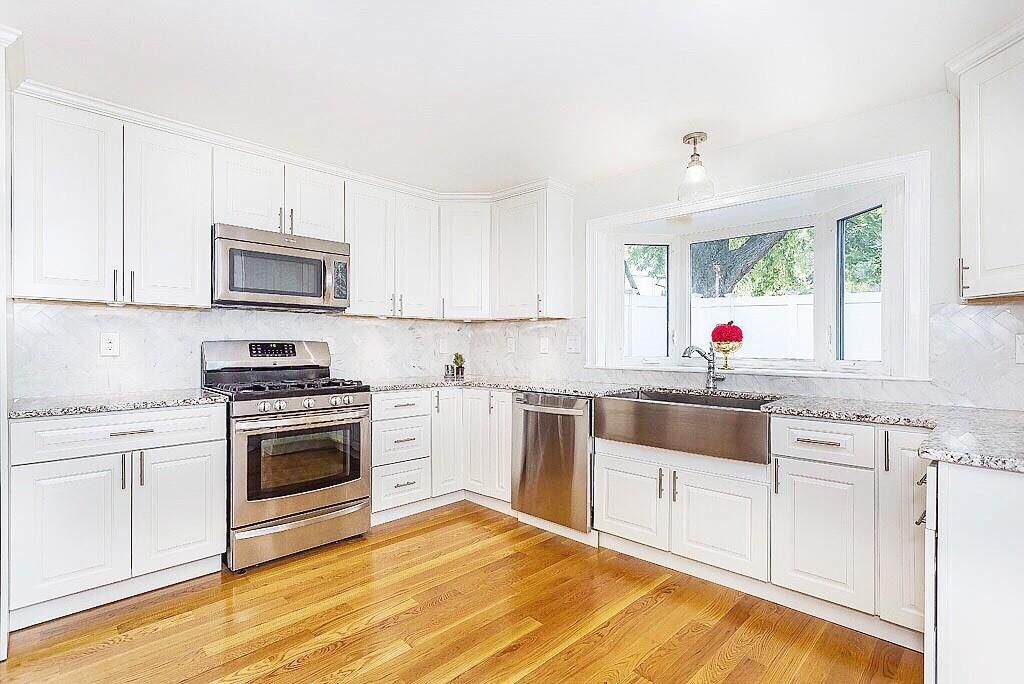 A spacious kitchen with an L-shaped counter.