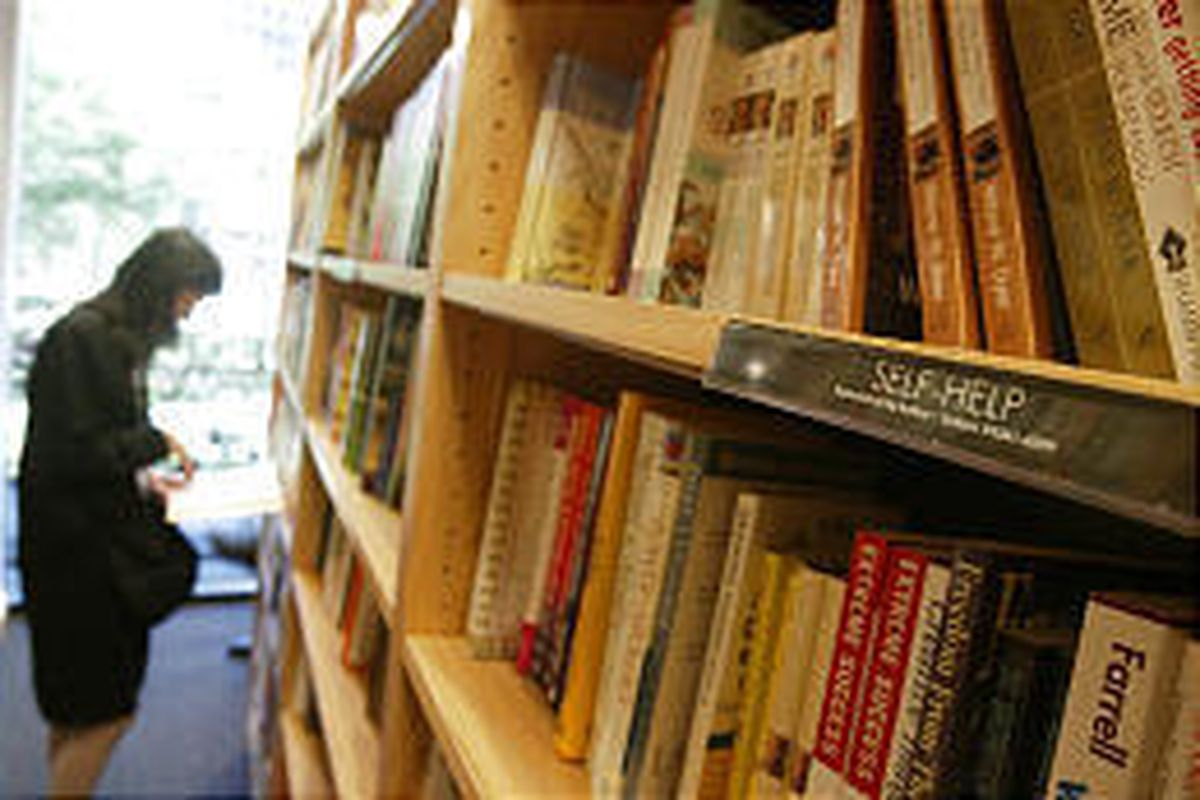 A woman peruses the self-help section of books at a Borders bookstore in New York City. At Borders Books, self-help books and products command a growing presence. Five years ago, said spokeswoman Jenie Carlen, self-help titles might have been confined to