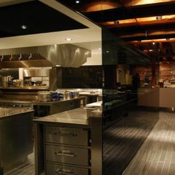 The massive kitchen, partially viewable from the dining area