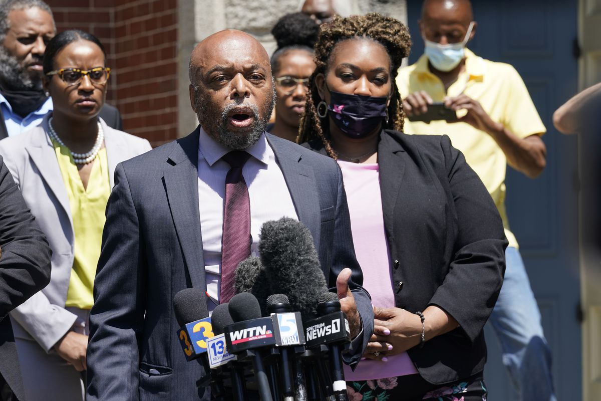 Attorneys for the family of Andrew Brown, Wayne Kendall, front, and Chantel Cherry-Lassiter, right, make comments after a judges decision on the release body cam video of the shooting of Andrew Brown Jr. in Elizabeth City, N.C., Wednesday, April 28, 2021.