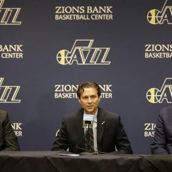 Quin Snyder, center, speaks to reporters after being introduced as the new Utah Jazz head coach, as Jazz CEO Greg Miller, right, and general manager Dennis Lindsey, left, look on during an NBA basketball news conference Saturday, June 7, 2014, in Salt Lake City.  The Jazz announced Friday that they hired the Atlanta Hawks assistant coach to replace Tyrone Corbin, who was let go earlier this year after three-plus seasons in Salt Lake City.  (AP Photo/Rick Bowmer)