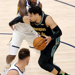 Memphis Grizzlies forward Dillon Brooks (24) hooks Utah Jazz forward Royce O'Neale (23) as the Utah Jazz and the Memphis Grizzlies play in game one of their NBA playoff series at Vivint Arena in Salt Lake City on Sunday, May 23, 2021. Memphis won 112-109.