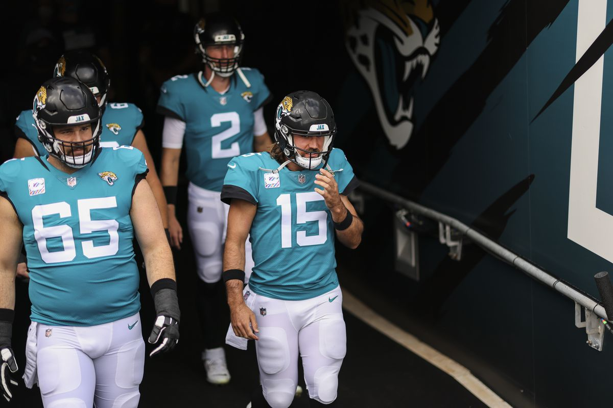 Gardner Minshew #15 of the Jacksonville Jaguars and teammates Mike Glennon #2 and Brandon Linder #65 enter the field before the start of a game against the Detroit Lions at TIAA Bank Field on October 18, 2020 in Jacksonville, Florida.