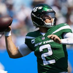 New York Jets quarterback Zach Wilson passes against the Carolina Panthers during the first half of an NFL football game Sunday, Sept. 12, 2021, in Charlotte, N.C.