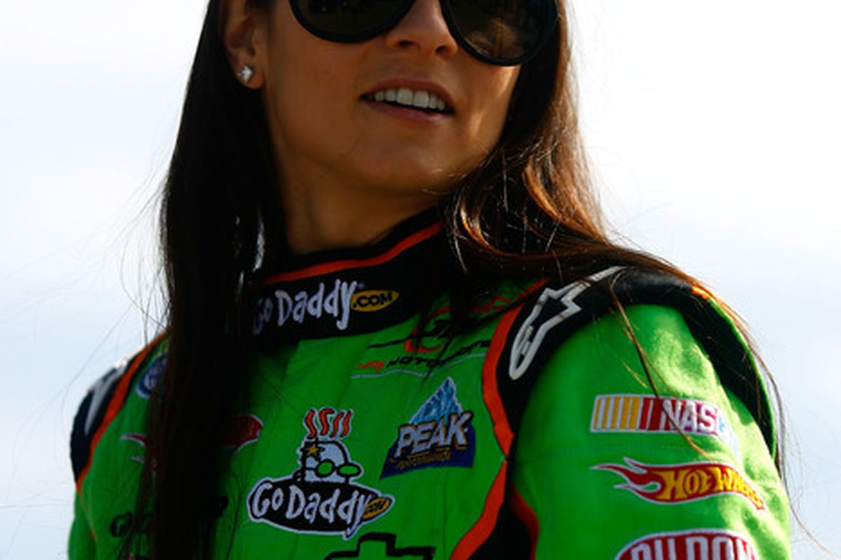 Danica Patrick will team with Aric Almirola at  JR Motorsports in the NASCAR Nationwide Series this season.