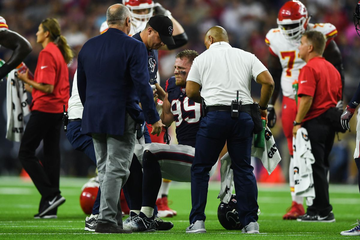 Houston Texans defensive end J.J. Watt is helped up after an injury