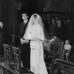 For her first wedding — to Roger Vadim on December 21th, 1952 — French actress Brigitte Bardot commissioned a traditional white gown from a local dressmaker named Madame Ogive.