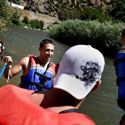 (CENTER) Rodney Boudrero and his friends Dustin Fabis and Thayne Sharp plan the rest of their excursion on the Weber River near Henefer on Thursday, August 6, 2009. Eleven Utahns lost their lives in boating-related accidents this year.  Seven of these victims would likely have survived had they worn a life jacket.  Utah State Park Boating Rangers are trying to educate people on water safety and to enforce the law to wear a life jacket. Life jackets are required by the State Boating Act to be worn by all individuals while on the river.