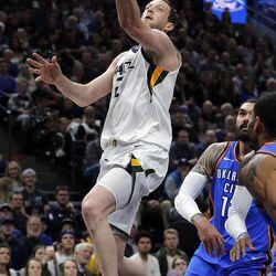 Utah Jazz forward Joe Ingles goes up for a shot against the Oklahoma City Thunder during NBA basketball in Salt Lake City on Saturday, Dec. 23, 2017.