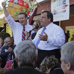 New Jersey Gov. Chris Christie, right, addresses a gathering while campaigning for New Hampshire Republican gubernatorial candidate Ovide Lamontagne, left, in Atkinson, N.H., Tuesday, Sept. 25, 2012.  Christie said electing Lamontagne as New Hampshire's governor is the only way to ensure the state doesn't end up with an income tax.