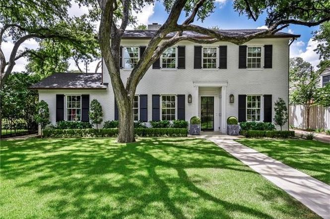Large two-story traditional white brick house