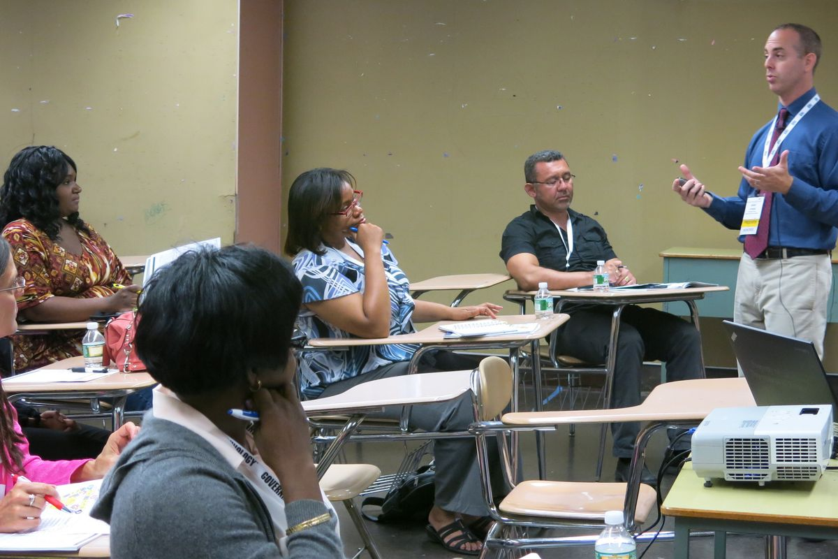 Teacher Adam Hyman introduced the flipped classroom teaching model at a professional development session Wednesday.