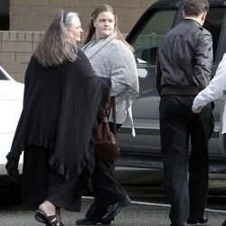 Terrica Powell, left, and her daughter Alina Powell leave following a memorial for Charlie and Braden Powell at the Life Center Church in Tacoma, Wash., Feb. 11, 2012.