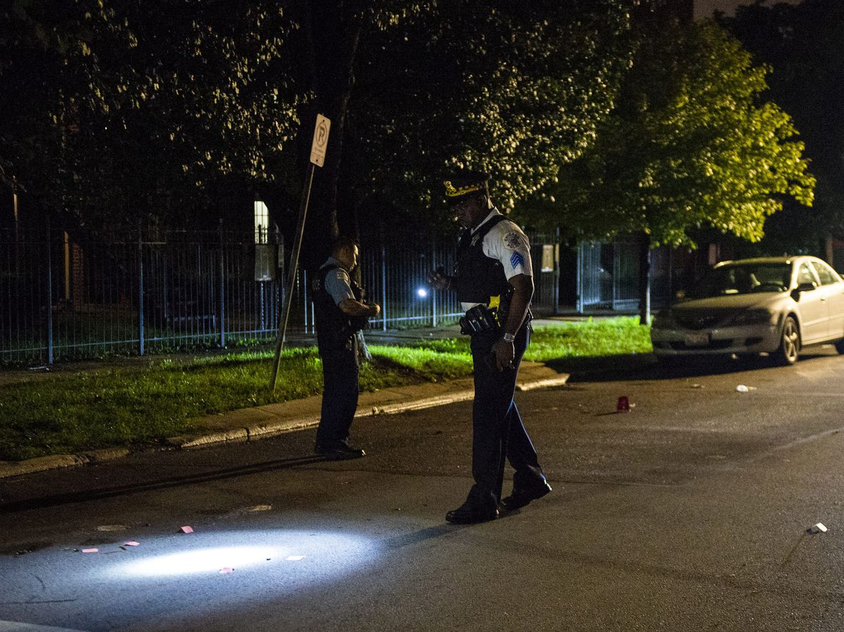 Police investigate a shooting about 11 p.m. Monday in the 7200 block of South Bennett | Tyler LaRiviere/Sun-Times