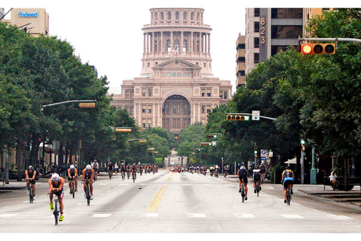 Bicyclists on Congress Avenue with Capitol in background