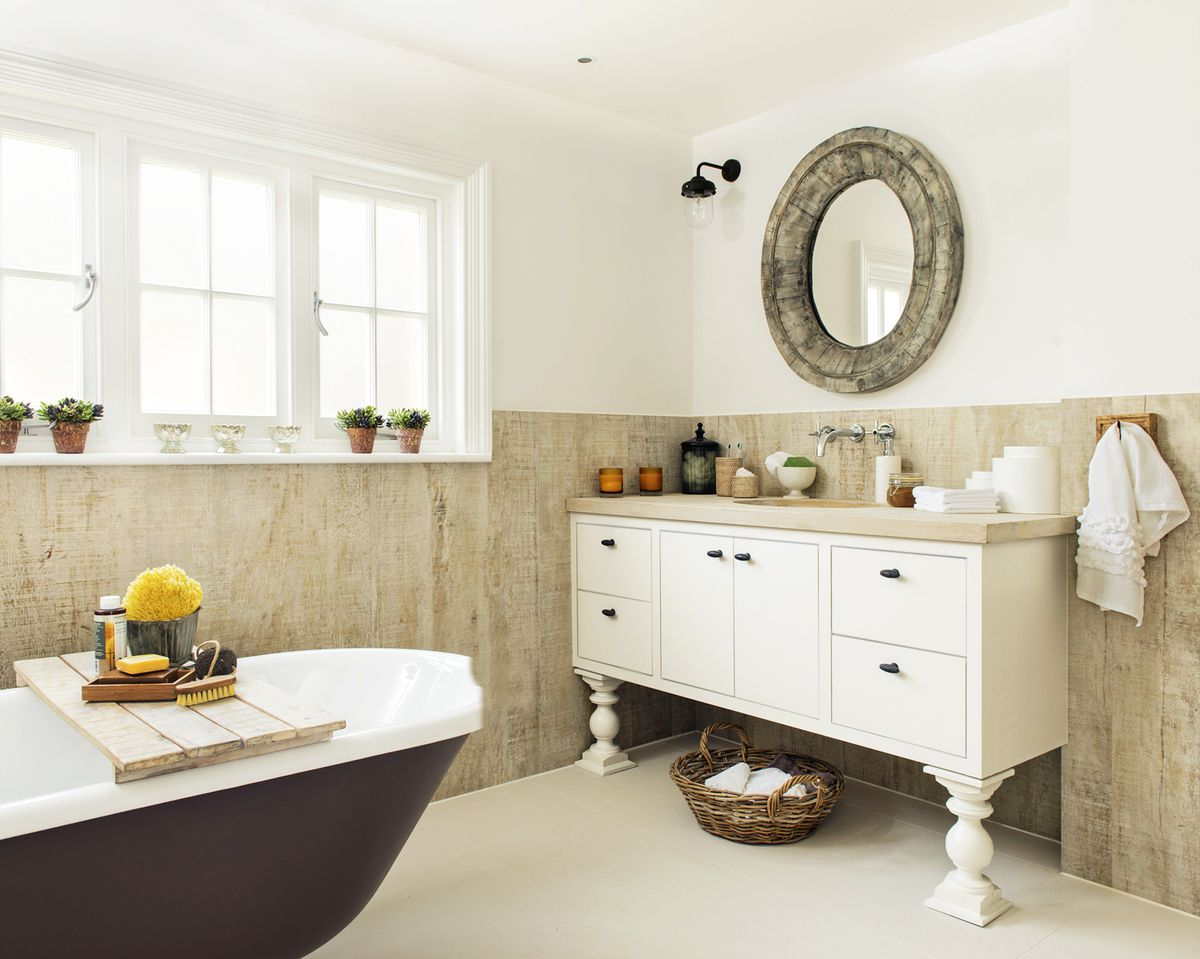 Barn wood planks used on bathroom walls and for frame for mirror above the sink.