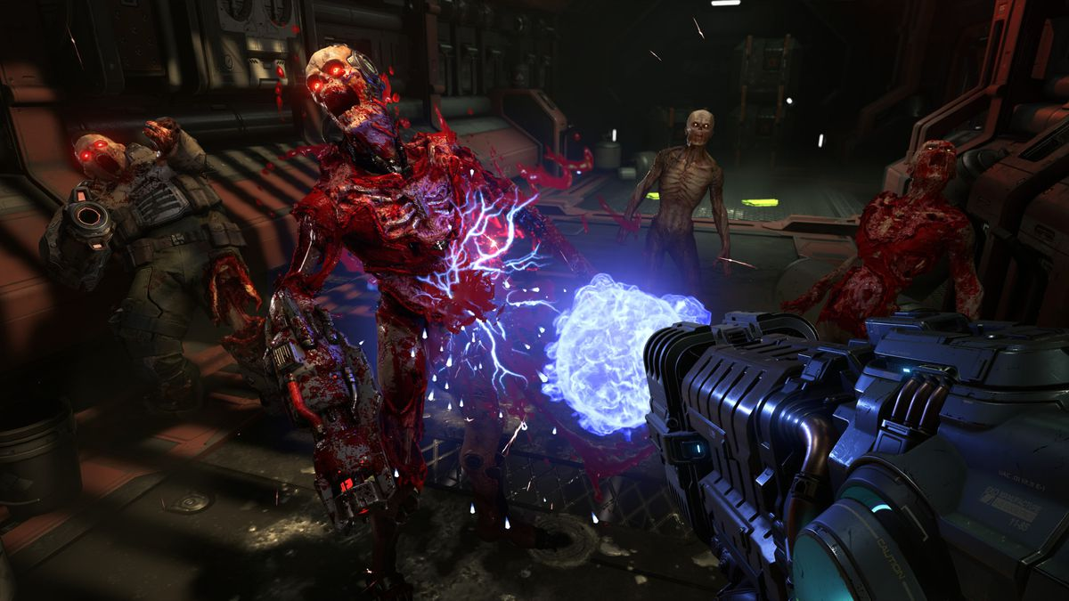 a weapon firing blue energy wipes out demons in a futuristic setting in Doom Eternal