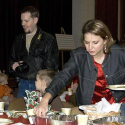 Josh and Susan Powell attend a church Christmas party.