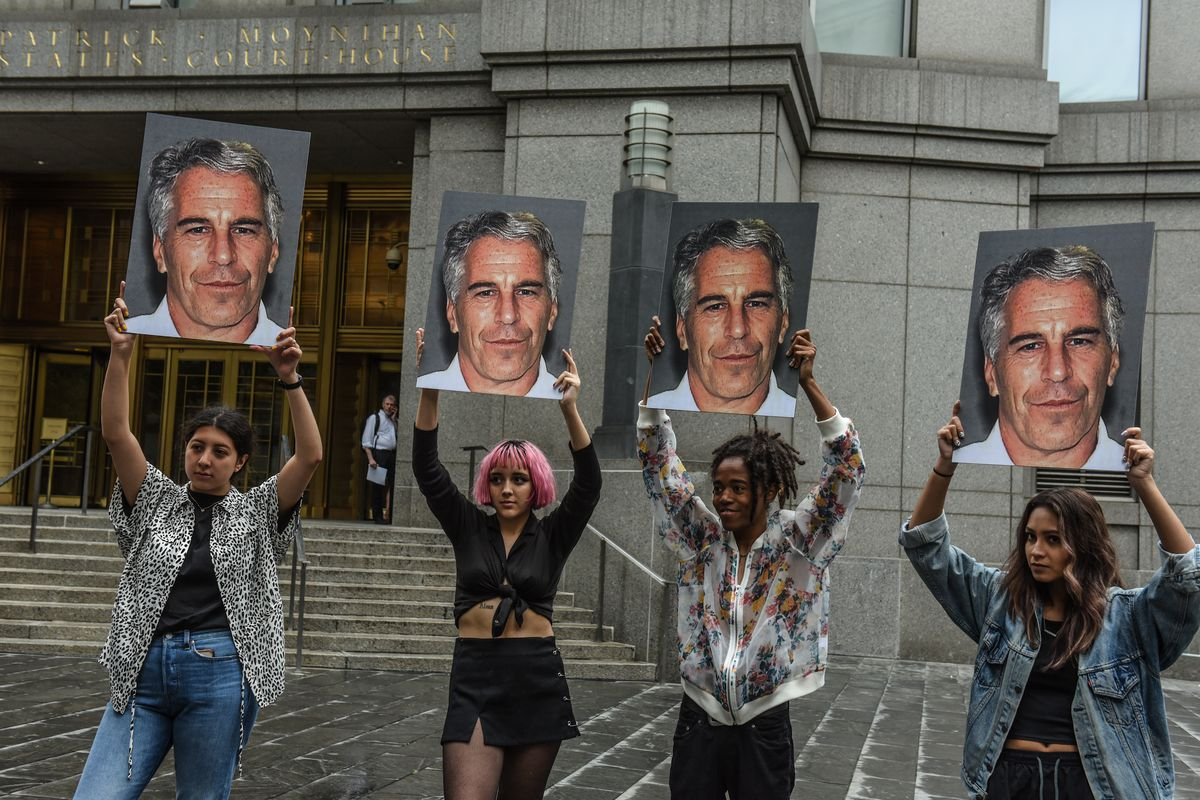 Protesters hold up signs with photos of Jeffrey Epstein in front of a New York City federal courthouse on July 8, 2019.