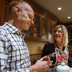 Jon and Michelle Schmidt prepare a meal in their home in Provo on Friday, Nov. 24, 2017.