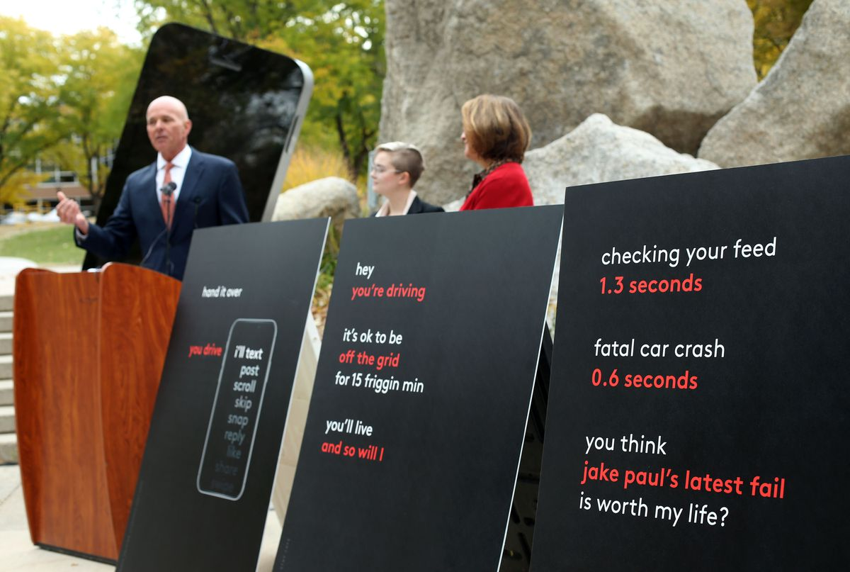 """Carlos Braceras, director of the Utah Department of Transportation, Kyra Ott, creative director of AdThing, and University of Utah President Ruth Watkins speak about the new campaign targeting distracted driving at the university in Salt Lake City on Thursday, Oct. 17, 2019. The """"You drive. I'll text"""" campaign encourages students to be active and attentive passengers by speaking up whenever they notice their drivers are distracted."""
