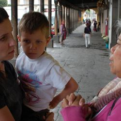 Kat Dayton and 5-year-old Oscar converse with a local woman near the central plaza in Antigua, Guatemala.