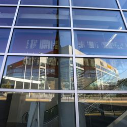 Vivint Smart Home Arena, home of the Utah Jazz, is reflected in the glass windows of the Salt Palace Convention Center in Salt Lake City on Oct. 28, 2020.
