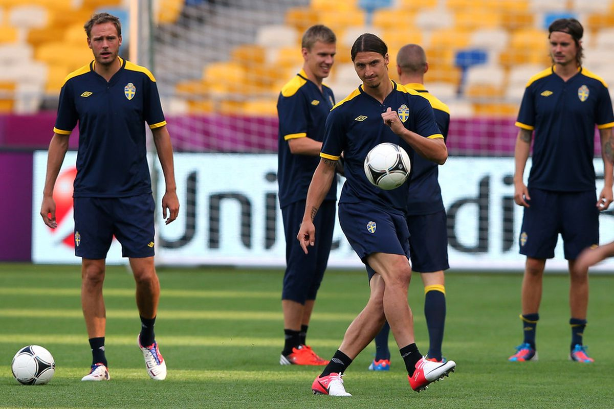 KIEV, UKRAINE - JUNE 10:  Zlatan Ibrahimovic of Sweden passes the ball during a UEFA EURO 2012 training session at the Olympic Stadium on June 10, 2012 in Kiev, Ukraine.  (Photo by Alex Livesey/Getty Images)