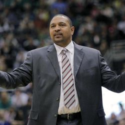 In this March 17, 2012, file photo, Golden State Warriors coach Mark Jackson questions a call by the officials during an NBA basketball game in Salt Lake City. Jackson is not making any playoff promises for the Warriors this season. Maybe itÍs a lesson learned for the poetic point guard and boisterous broadcaster turned NBA coach. Or maybe heÍs just tempering expectations entering his second season considering, well, there actually are expectations with a reshaped roster built around center Andrew Bogut and point guard Stephen Curry.
