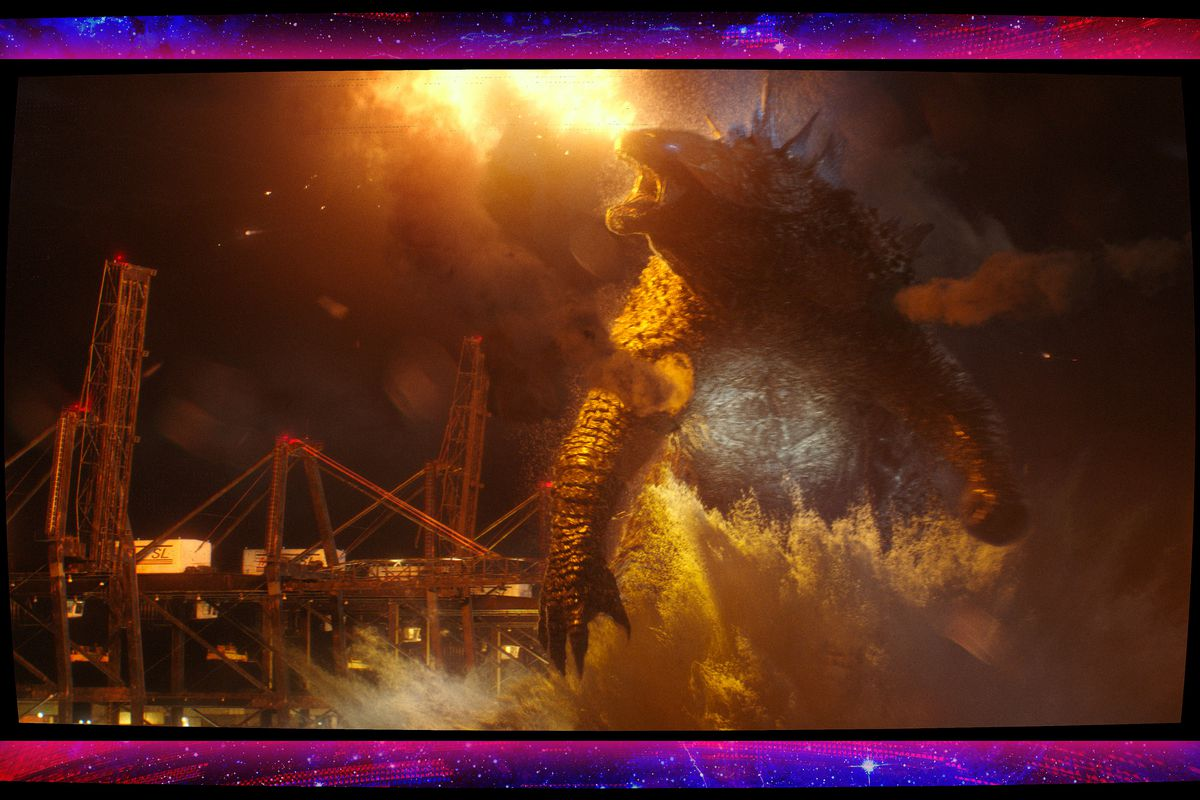 Godzilla stands in front of a city in Godzilla vs Kong