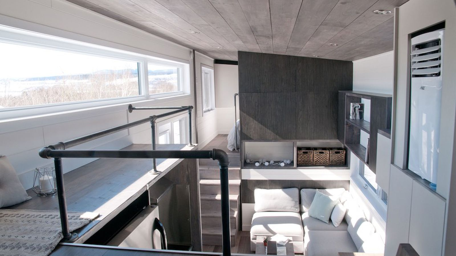 Tiny house with private 'bedroom' offers minimalist chic