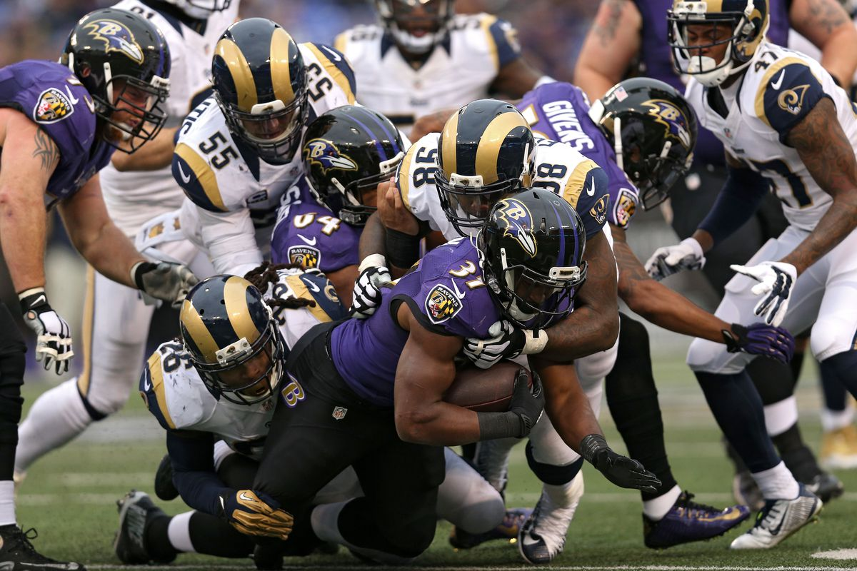 Baltimore Ravens RB Javorius Allen is tackled by St. Louis Rams DT Nick Fairley in a Week 11 loss, November 22, 2015.