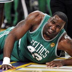 Celtics center Kendrick Perkins lies on the floor after a first-half knee injury.